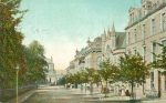 1906: Beaumont Street, Hexham. Tinted; looking NE, Abbey, Trinity Church, Queen's Hall
