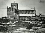 1869: Abbey looking N from Church Row, old graveyard being cleared to make Beaumont Street, man in top hat seated on tree stump