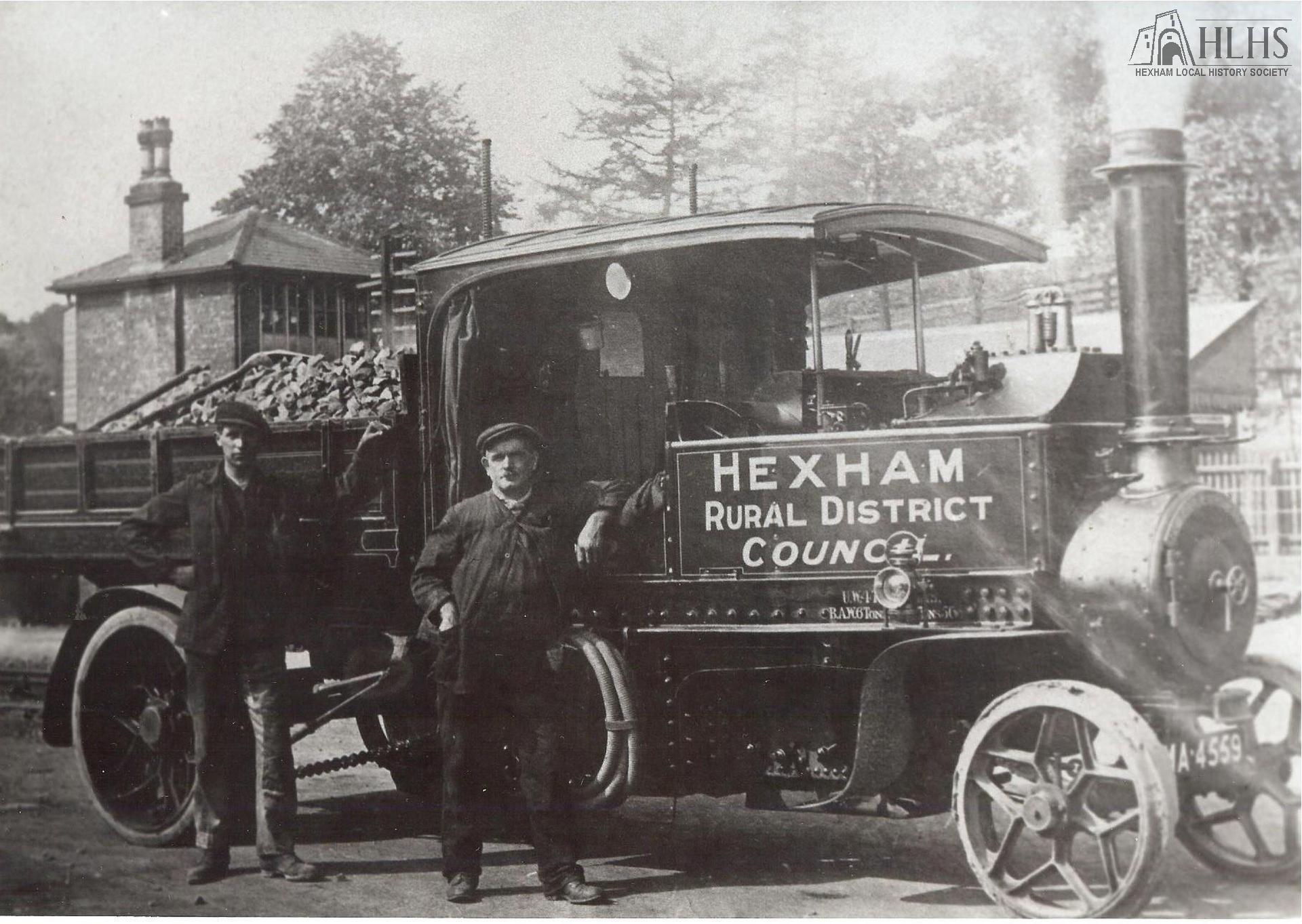 1920s: Hexham RDC steam lorry, with two workmen