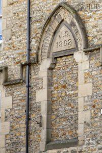 2020: Eastgate W side, stonework on side of No 1 Tap & Spile pub